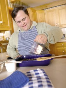 Adult man with developmental disabilities in the kitchen